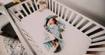 Adjusting Your Baby's Crib Mattress: Why, How & When